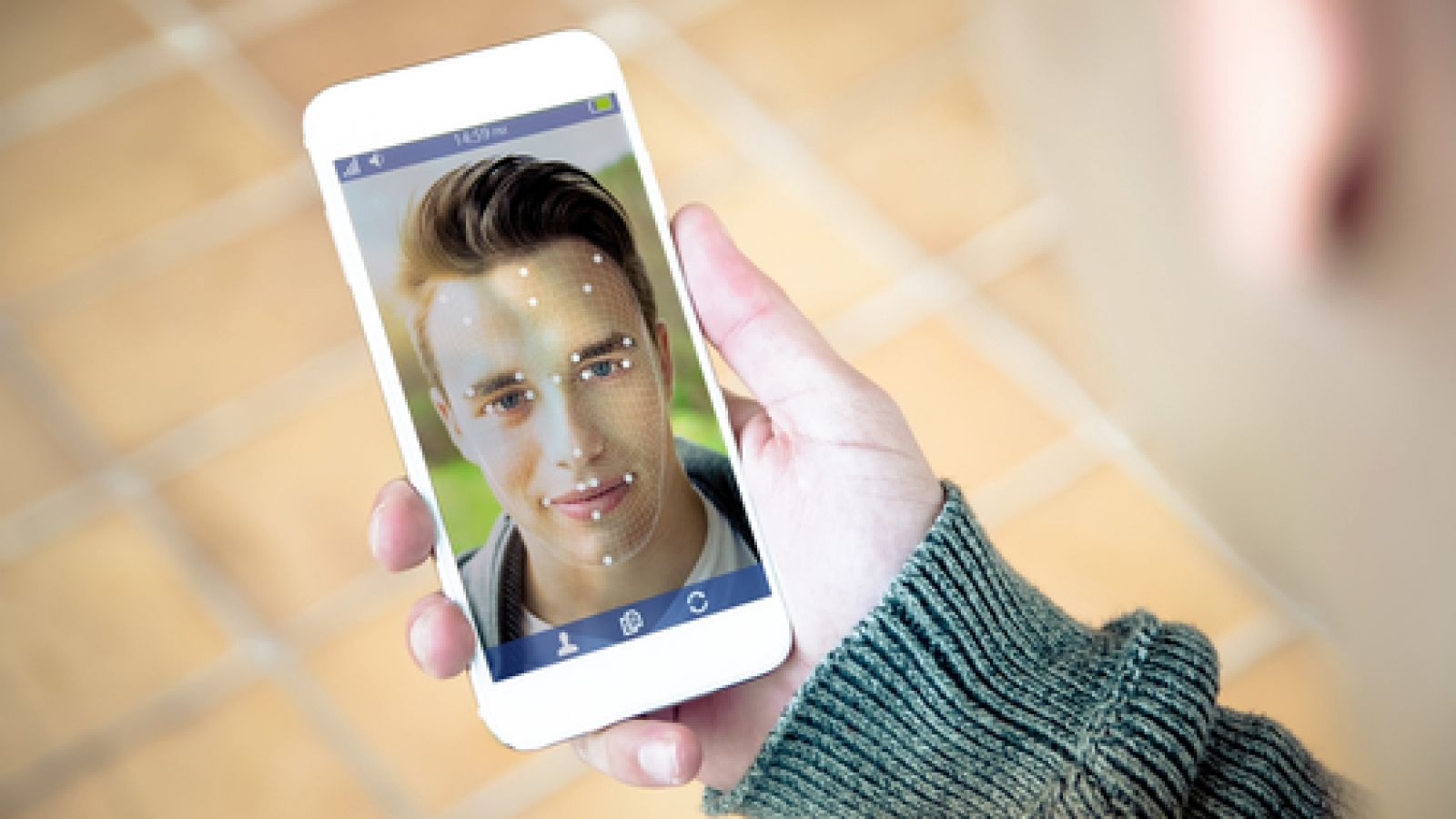 millennial using face id technology on smartphone